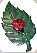 Metal leaf with ladybirds